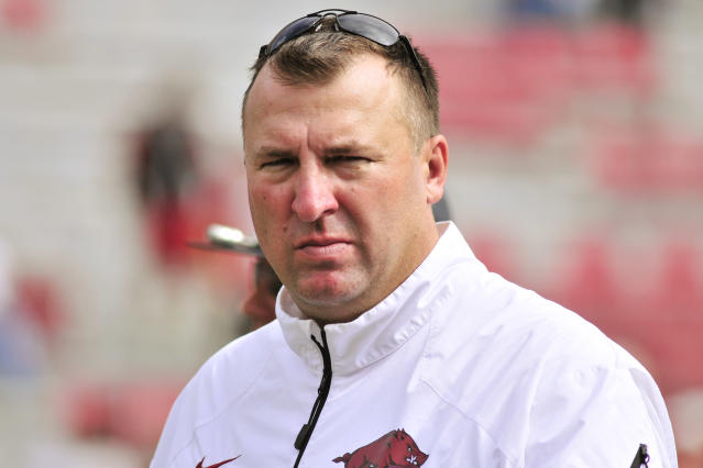 File- This Oct. 12, 2013 file photo shows Arkansas coach Bret Bielema leaving the field after an NCAA college football game against South Carolina in Fayetteville, Ark. Bielema engaged in some back-and-fort with Auburn coach Gus Malzahn during the summer about the pace of college offenses. The two will finally meet on the field this week when the surging Tigers visit the Razorbacks, losers of five straight who are coming off a bye. (AP Photo/April L. Brown, File)