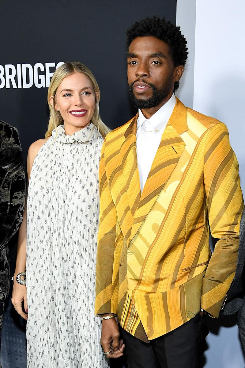 "Sienna Miller and Chadwick Boseman attend a screening of  ""21 Bridges"" in November 2019, in which they both starred. In a new interview, Miller details an act of generosity on Boseman's part that took her by surprise. (Photo: Dimitrios Kambouris via Getty Images)"
