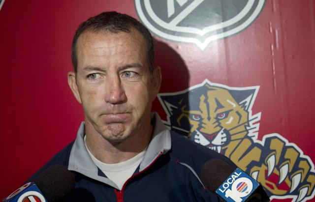 FILE - In this Sept. 14, 2012 file photo, Florida Panthers hockey coach Kevin Dineen talks to the media, after an informal skate in Coral Springs, Fla. Dineen has been fired as coach of the Panthers. The team made the announcement Friday, Nov. 8, 2013, one day after their losing streak reached seven with a 4-1 loss at Boston. Also fired were assistants Gord Murphy and Craig Ramsay. Peter Horachek is the Panthers' interim head coach. (AP Photo/J Pat Carter, File)