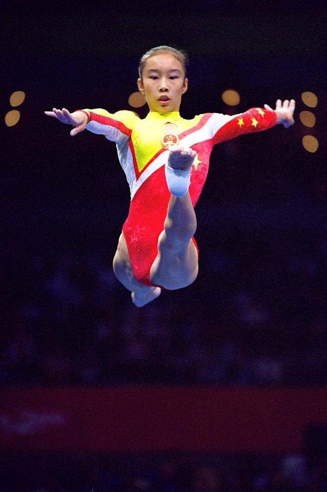 25 Sep 2000: Jie Ling of China in action during the Womens Gymnastics Beam Final at the Sydney Superdome on Day Ten of the Sydney 2000 Olympic Games in Sydney, Australia. \ Mandatory Credit: Shaun Botterill /Allsport