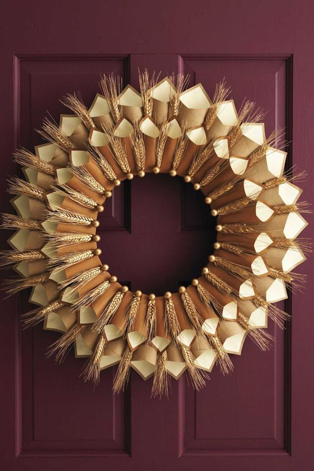 """<p>Once your Thanksgiving dinner guests get settled, encourage them to write down what they're most grateful for on a small piece of paper and slip it into the wreath's paper cones. </p><p><em><a href=""""https://www.womansday.com/home/crafts-projects/how-to/a5356/thanksgiving-craft-paper-cone-gratitude-wreath-112583/"""" target=""""_blank"""">Get the tutorial at Woman's Day »</a></em></p>"""