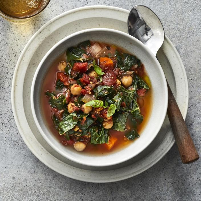 <p>This Mediterranean stew is a healthy dinner chock-full of vegetables and hearty chickpeas. A drizzle of olive oil to finish carries the flavors of this easy vegan crock-pot stew. Swap out the chickpeas for white beans for a different twist, or try collards or spinach in place of the kale. Any way you vary it, this stew is sure to go into heavy rotation when you are looking for healthy crock-pot recipes.</p>