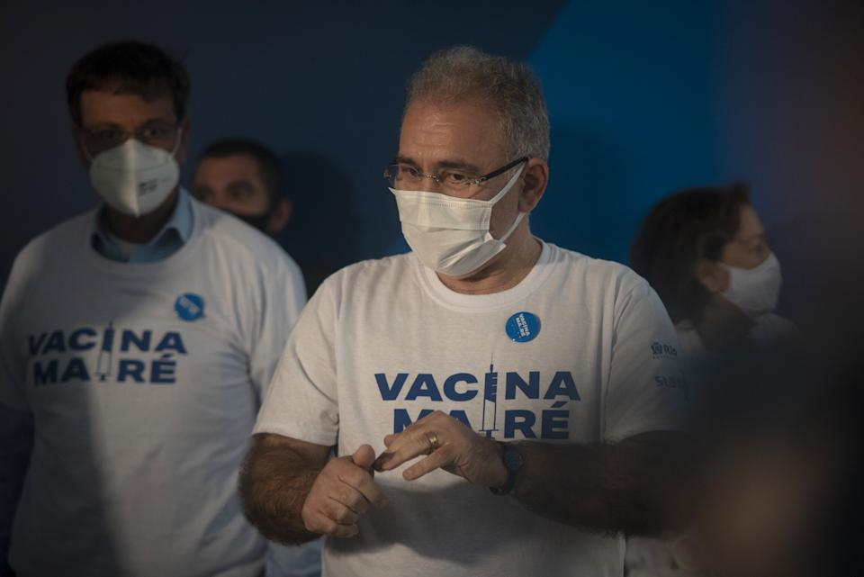 RIO DE JANEIRO, BRAZIL - AUGUST 3: Brazil's Health Minister Marcelo Queiroga participates in mass vaccination against Covid-19 for residents of the Mare favela Complex, in Rio de Janeiro, Brazil on August 03, 2021. Health Minister Marcelo Queiroga said at a press conference that the portfolio under his command has no