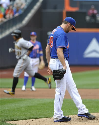 New York Mets starting pitcher Jonathon Niese kicks dirt on the mound as Pittsburgh Pirates' Jose Tabata rounds third base after hitting a two-run home run in third inning of a baseball game at Citi Field on Saturday, May 11, 2013 in New York. (AP Photo/Kathy Kmonicek)