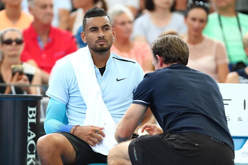 Battling the pain: Nick Kyrgios, receiving treatment in Brisbane today, has offered his sympathy to Andy Murray: Getty Images