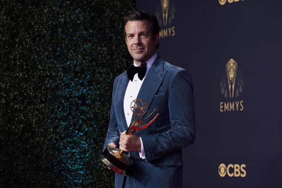 """Jason Sudeikis, winner of the award for outstanding lead actor in a comedy series for """"Ted Lasso"""" poses the 73rd Primetime Emmy Awards on Sunday, Sept. 19, 2021, at L.A. Live in Los Angeles. (AP Photo/Chris Pizzello)"""