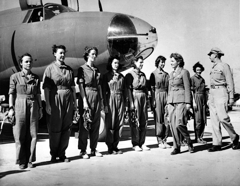 FILE - This Sept. 22, 1942 black-and-white file photo shows Aviatrix Nancy Harkness Love, director of the Women's Auxiliary Ferry Squadron (WAFS), and Col. Robert H. Baker, commanding officer, inspect the first contingent of women pilots in the WAFS at the New Castle Army Air Base, Del. Women served and died on the nation's battlefields from the first. They were nurses and cooks, spies and couriers in the Revolutionary War. Some disguised themselves as men to fight for the Union or the Confederacy. Yet the U.S. military's official acceptance of women in combat took more than two centuries. New roles for females were doled out fitfully _ whenever commanders got in a bind and realized they needed women's help. A look at milestones on the way to lifting the ban on women in ground combat.  (AP Photo, File)
