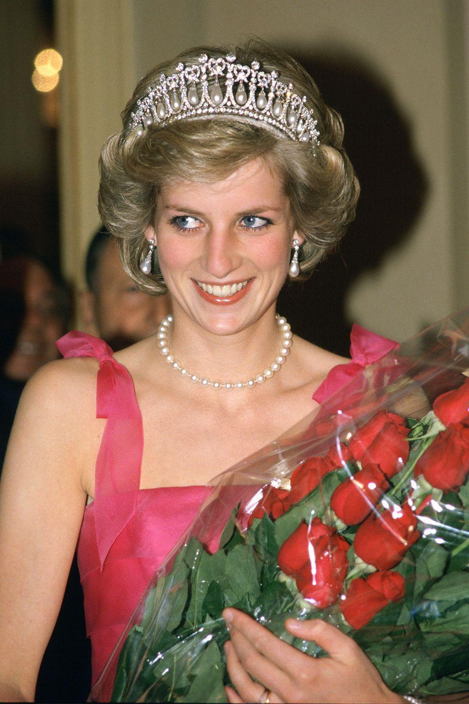<p>In a diamond and pearl tiara at the La Scala Opera House for a performance during her official tour of Milan, Italy. </p>
