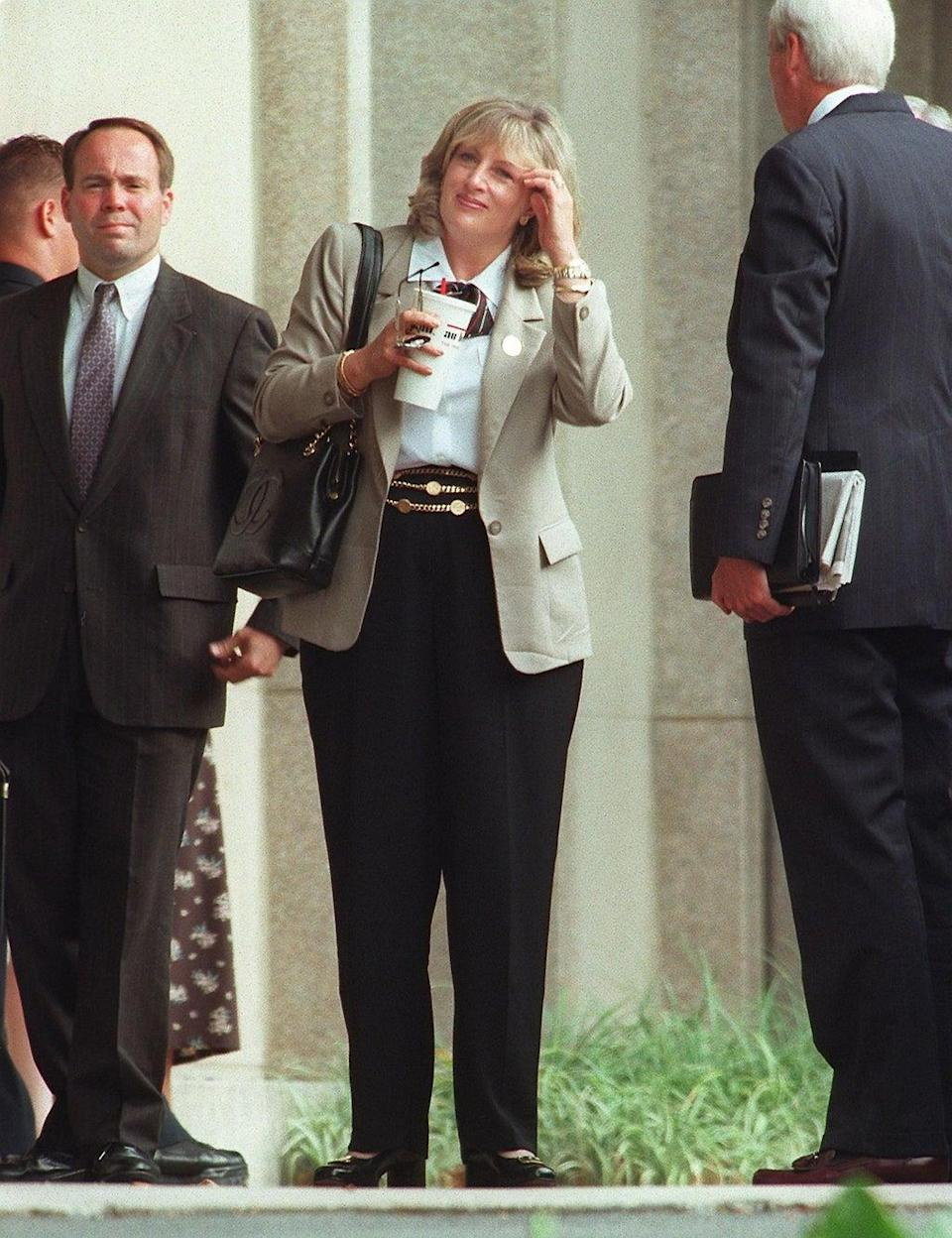Linda Tripp, who secretly taped conversations with Monica Lewinsky, arrives on 9 July 1998 at the US District Courthouse in Washington, DC (TIM SLOAN/AFP via Getty Images)