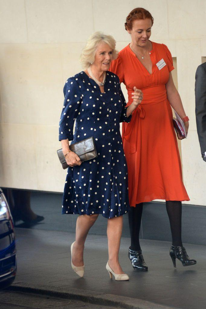 <p>Camilla brought a luxe touch to the Woman Of The Year Awards Lunch in London, England with this navy velvet polkadot dress. </p>