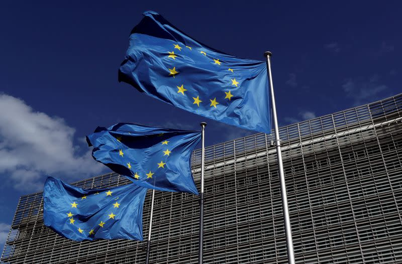 FILE PHOTO: European Union flags flutter outside the European Commission headquarters in Brussels