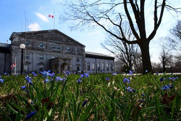 Spring flowers bloom as the Canada flag flies at half mast at  Rideau Hall, in Ottawa on Friday, April 9, 2021, following the death of Prince Philip. THE CANADIAN PRESS/Sean Kilpatrick