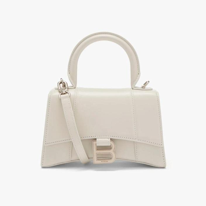 """$1890, MATCHESFASHION.COM. <a href=""""https://www.matchesfashion.com/us/products/Balenciaga-Hourglass-XS-leather-bag-1413651"""" rel=""""nofollow noopener"""" target=""""_blank"""" data-ylk=""""slk:Get it now!"""" class=""""link rapid-noclick-resp"""">Get it now!</a>"""