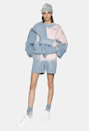 """Speaking of tie-dye, say hello to acid wash—its edgier cousin. The muted blue-grey and pink combo is <em>chef's kiss</em> for anyone looking to bring some grungy <a href=""""https://www.glamour.com/story/how-to-dress-90s?mbid=synd_yahoo_rss"""" rel=""""nofollow noopener"""" target=""""_blank"""" data-ylk=""""slk:'90s vibes"""" class=""""link rapid-noclick-resp"""">'90s vibes</a> into their wardrobe. $125, Madhappy. <a href=""""https://www.madhappy.com/collections/womens/products/sunburst-heritage-short?variant=32294951551087"""" rel=""""nofollow noopener"""" target=""""_blank"""" data-ylk=""""slk:Get it now!"""" class=""""link rapid-noclick-resp"""">Get it now!</a>"""