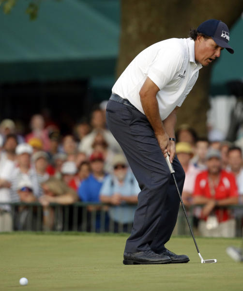 Phil Mickelson reacts after missing a putt on the 18th hole during the third round of the U.S. Open golf tournament at Merion Golf Club, Saturday, June 15, 2013, in Ardmore, Pa. (AP Photo/Morry Gash)