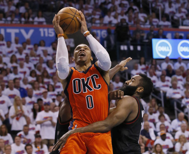 FILE - In this Sunday, April 23, 2017 file photo, Oklahoma City Thunder guard Russell Westbrook (0) shoots between Houston Rockets guard Patrick Beverley, rear, and guard James Harden, right, in the fourth quarter of Game 4 of a first-round NBA basketball playoff series in Oklahoma City. Olympic swimmer Michael Phelps and Oklahoma City Thunder star Russell Westbrook are among the finalists for best male athlete at the ESPY Awards. Tennis star Serena Williams and gymnast Simone Biles are two of the finalists for best female athlete. (AP Photo/Sue Ogrocki, File)