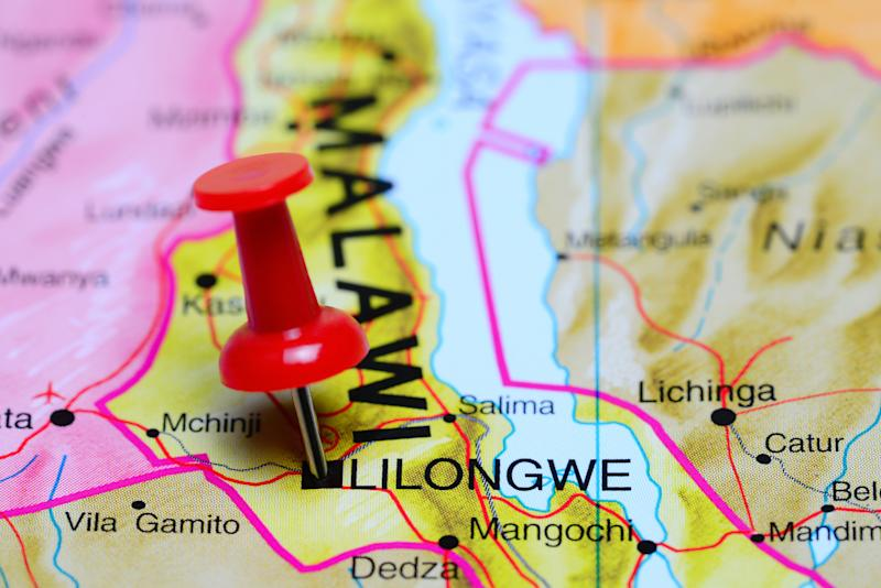 Photo of pinned Lilongwe on a map of Africa. May be used as illustration for traveling theme.