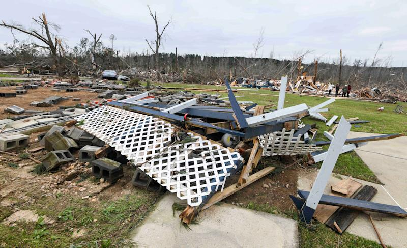 Debris litters the property of a destroyed home on Lee County Road 63 in Beauregard, Ala., Monday, March 4, 2019, the day after a deadly tornado ravaged the area. (Photo: Julie Bennett/AP)