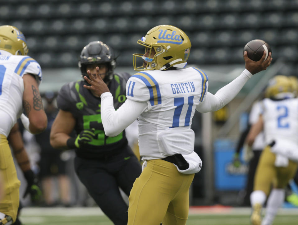 UCLA's Chase Griffin throws downfield against Oregon during the second quarter of an NCAA college football game Saturday, Nov. 21, 2020, in Eugene, Ore. (AP Photo/Chris Pietsch)