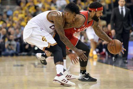 May 19, 2016; Cleveland, OH, USA; Cleveland Cavaliers guard Iman Shumpert (4) reaches for a loose ball in front of Toronto Raptors forward James Johnson (3) during the second quarter in game two of the Eastern conference finals of the NBA Playoffs at Quicken Loans Arena. Mandatory Credit: Ken Blaze-USA TODAY Sports