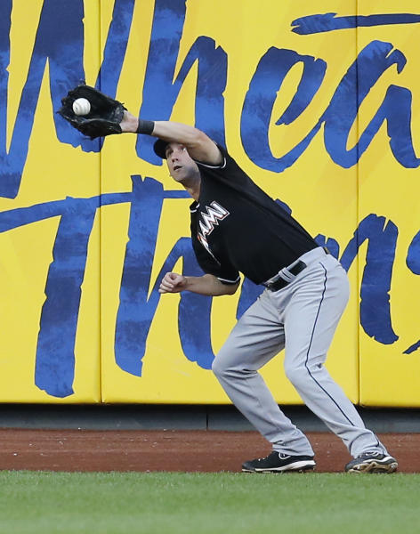Miami Marlins' Ed Lucas catches a long fly ball hit by New York Mets' Daniel Murphy to record the last out of the 20th inning in the Marlins 2-1 in a baseball game at Citi Field in New York, Saturday, June 8, 2013. (AP Photo/Paul J. Bereswill)