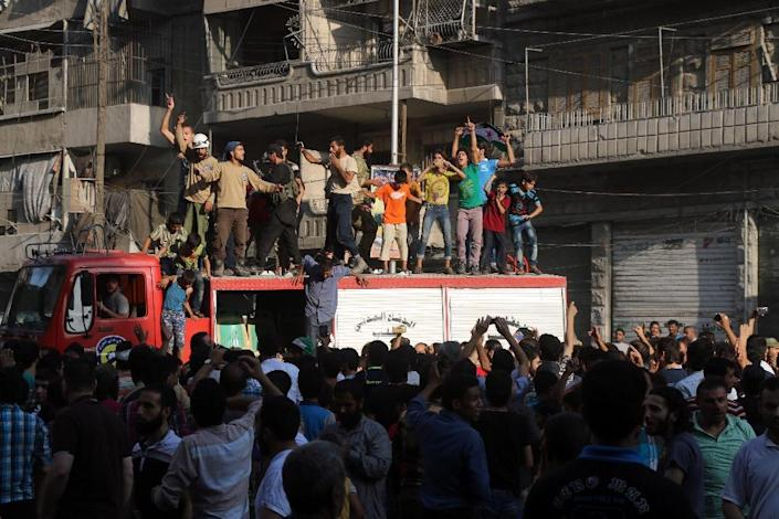 Syrian gather in a street in Aleppo on August 6, 2016, in celebrations after rebels said they have broken a three-week government siege on Syria's second city (AFP Photo/Thaer Mohammed)