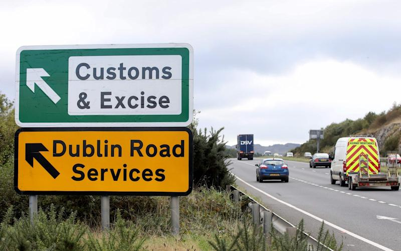 """Signs point to an old customs and excise area on the Dublin road in Newry, Northern Ireland, on October 1, 2019 on the border between Newry in Northern Ireland and Dundalk in the Irish Republic. - Britain will give the EU new proposals for a Brexit deal """"shortly"""", Prime Minister Boris Johnson said on October 1, but rejected reports it would see customs posts along the Irish border - PAUL FAITH/AFP/GETTY IMAGES"""