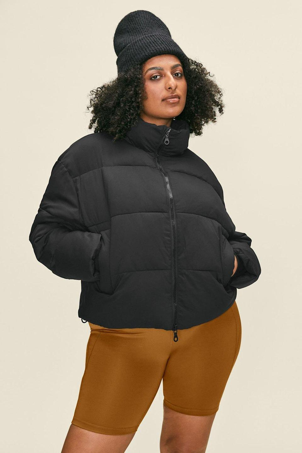 """Because everyone needs a cute <a href=""""https://www.glamour.com/story/how-to-wear-puffer-jacket-fall-outfits?mbid=synd_yahoo_rss"""" rel=""""nofollow noopener"""" target=""""_blank"""" data-ylk=""""slk:puffer coat"""" class=""""link rapid-noclick-resp"""">puffer coat</a> for winter, and this one is light, warm, and sustainable. $198, Girlfriend Collective. <a href=""""https://www.girlfriend.com/products/black-crop-puffer"""" rel=""""nofollow noopener"""" target=""""_blank"""" data-ylk=""""slk:Get it now!"""" class=""""link rapid-noclick-resp"""">Get it now!</a>"""