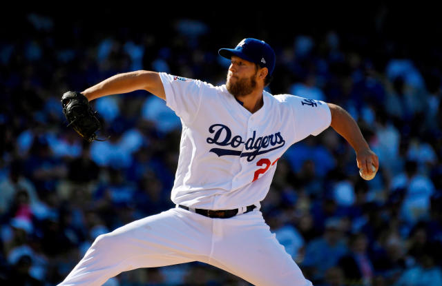 FILE - In this March 29, 2018, file photo, Los Angeles Dodgers starting pitcher Clayton Kershaw throws during the fifth inning of the team's baseball game against the San Francisco Giants in Los Angeles. The marquee pitching matchup of the young season takes place in Los Angeles, where Nationals ace Max Scherzer faces Kershaw and the Dodgers on Friday. (AP Photo/Mark J. Terrill, File)