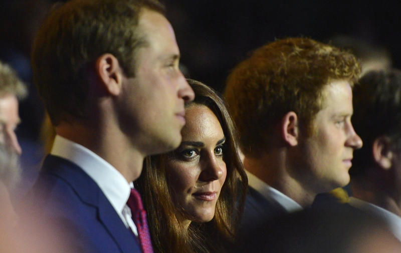 Britain's Prince William, the Duke of Cambridge, Britain's Catherine, Duchess of Cambridge and Britain's Prince Harry, from left, attend the Opening Ceremony of the 2012 Olympic Summer Games at the Olympic Stadium in London, Friday, July 27, 2012. (AP Photo/Toby Melville, pool)