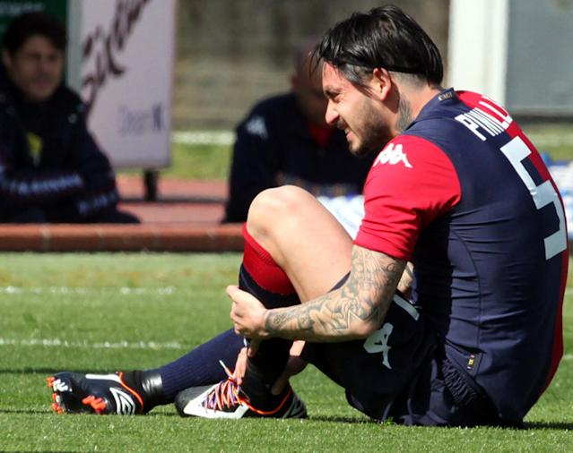 Rainbow coloured shoelaces are seen on Mauricio Pinilla's shoes as he touches his ankle during an Italian Serie A soccer match between Cagliari and Udinese, in Cagliari, Italy, Sunday, March 2, 2014. More Serie A players are wearing rainbow-colored shoelaces this weekend in an expanding anti-homophobia demonstration. Cagliari midfielder Daniele Dessena received online attacks after wearing the laces last weekend and as a result three teammates _ South Americans Fernando Avelar, Victor Ibarbo and Mauricio Pinilla _ joined him in wearing the multi-colored laces for Sunday's match with Udinese. (AP Photo/Enrico Locci, Lapresse)
