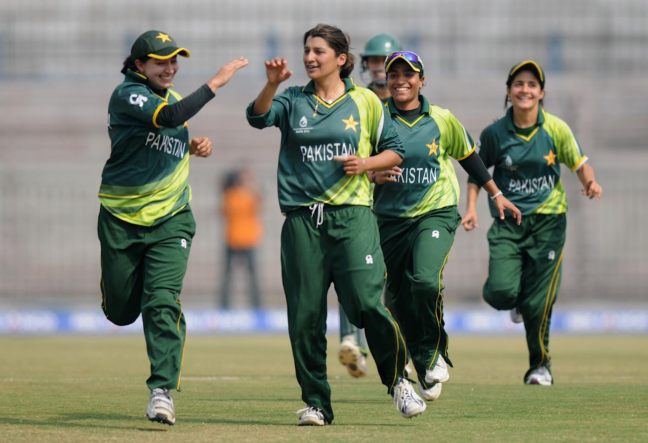 CUTTACK, INDIA - FEBRUARY 01:  Asmavia Iqbal of Pakistan celebrates the wicket of Jodie Fields of Australia with teammates during the second match of ICC Womens World Cup between Australia and Pakistan, played at the Barabati stadium on February 1, 2013 in Cuttack, India.  (Photo by Pal Pillai-ICC/ICC via Getty Images)