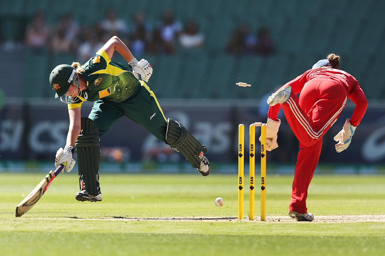 MELBOURNE, AUSTRALIA - JANUARY 31:  Meg Lanning of Australia makes her ground during game two of the International Twenty20 series between Australia and England at the Melbourne Cricket Ground on January 31, 2014 in Melbourne, Australia.  (Photo by Michael Dodge/Getty Images)