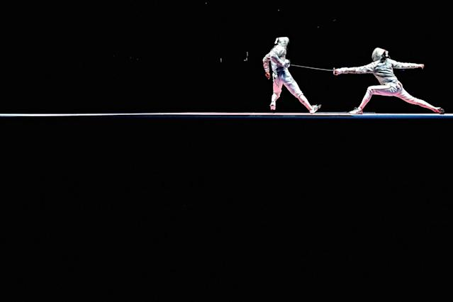 <p>Aron Szilagyi of Hungary and Aliaksandr Buikevich of Belarus compete during the men's individual sabre on Day 5 of the Rio 2016 Olympic Games at Carioca Arena 3 on August 10, 2016 in Rio de Janeiro, Brazil. (Photo by Cameron Spencer/Getty Images) </p>