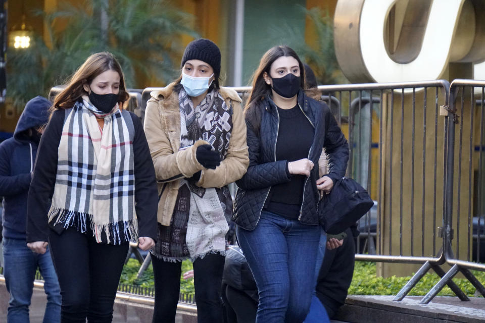 Pedestrians face severe cold in Sao Paulo, Brazil, on July 2, 2021. (Photo by Cris Faga/NurPhoto via Getty Images)