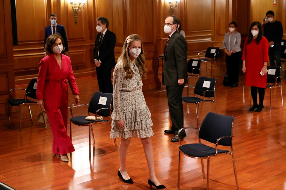 Spain's Princess Leono arrives with Spain's Deputy Prime Minister Carmen Calvo, left, for an event to commemorate the 30th anniversary of the Cervantes Institute in Madrid, Spain, Wednesday March 24, 2021. This is the first time Princess Leonor has presided an official event alone without the presence of her father, King Felipe VI. (Ballesteros/Pool photo via AP)