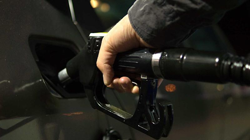 Filling a car with fuel at a petrol station