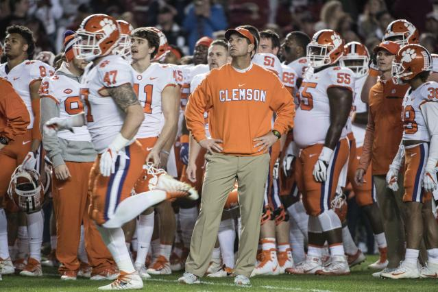 Clemson head coach Dabo Swinney stands with his team before an NCAA college football game against South Carolina on Saturday, Nov. 25, 2017, in Columbia, S.C. Clemson defeated South Carolina 34-10. (AP Photo/Sean Rayford)