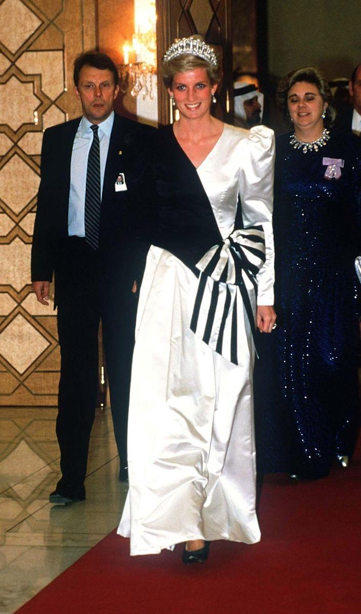 <p>In true 1980s fashion, Princess Diana wore a black and white evening gown with a giant bow in the front to a royal wedding in Saudi Arabia. The royal also wore the ultimate piece of jewelry: a stunning tiara. </p>