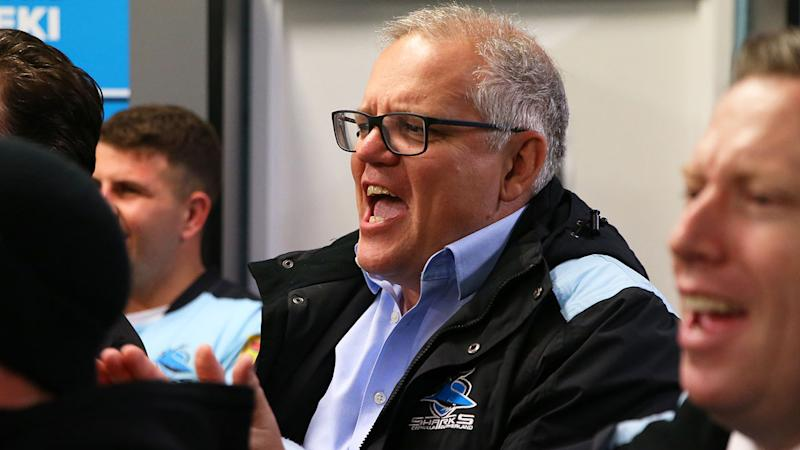 Pictured here, Prime Minister Scott Morrison cheering on the Cronulla Sharks in the NRL.