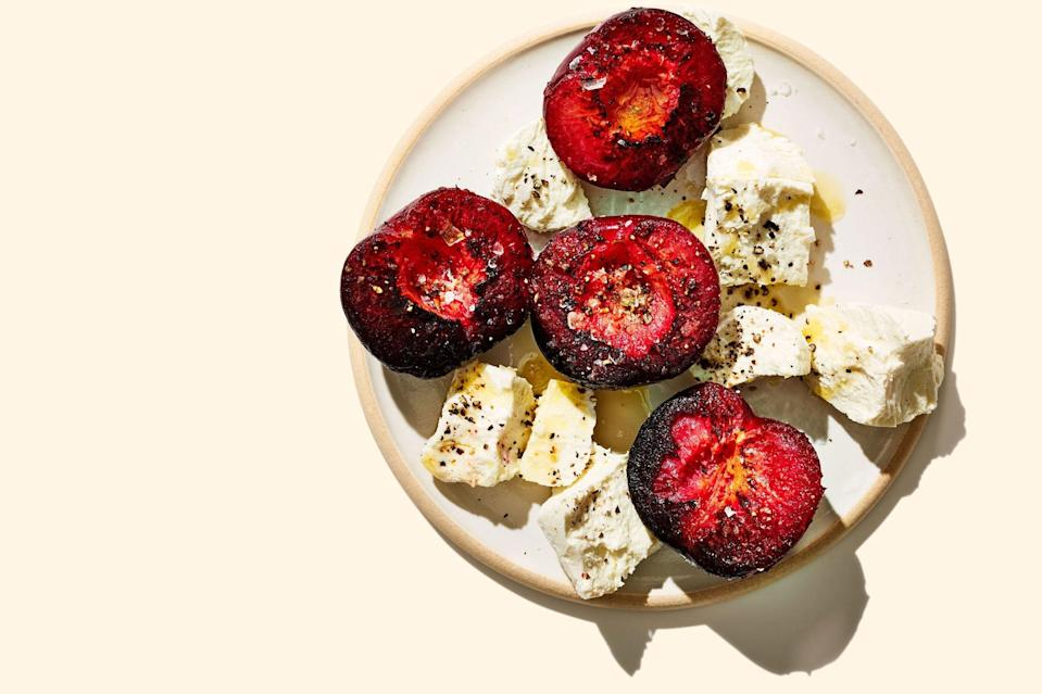 """Start the weekend off with a cheese plate that doesn't pull any punches. Big wedges of creamy goat cheese (salty feta, pungent blue, or an oozy bloomy rind cheese would work too) are nestled among halved <a href=""""https://www.epicurious.com/ingredients/how-to-eat-all-the-plums-gallery?mbid=synd_yahoo_rss"""" rel=""""nofollow noopener"""" target=""""_blank"""" data-ylk=""""slk:plums"""" class=""""link rapid-noclick-resp"""">plums</a> that get charred in butter. Pro tip: Drizzle the leftover butter over toast points before schmearing with the softened fruit and cheese. <a href=""""https://www.epicurious.com/recipes/food/views/charred-buttered-plums-with-cheese?mbid=synd_yahoo_rss"""" rel=""""nofollow noopener"""" target=""""_blank"""" data-ylk=""""slk:See recipe."""" class=""""link rapid-noclick-resp"""">See recipe.</a>"""