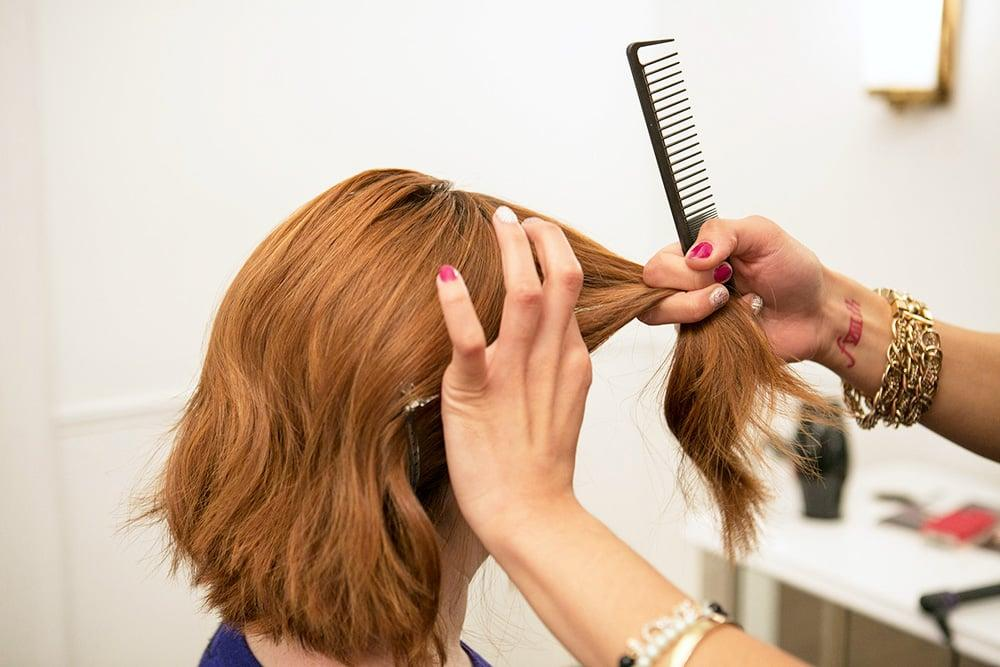 <p>It's best to start on second-day hair, but if you're working with a freshly cleansed scalp, first blow-dry and then add a pomade to give your hair some grip. Huffnagle recommends using any type of cream or serum to keep your braid polished with minimal flyaways.</p> <p>Then section your hair from ear to ear, pulling the back section away and securing with a clip. The top section is what will turn into your braided headband.</p>