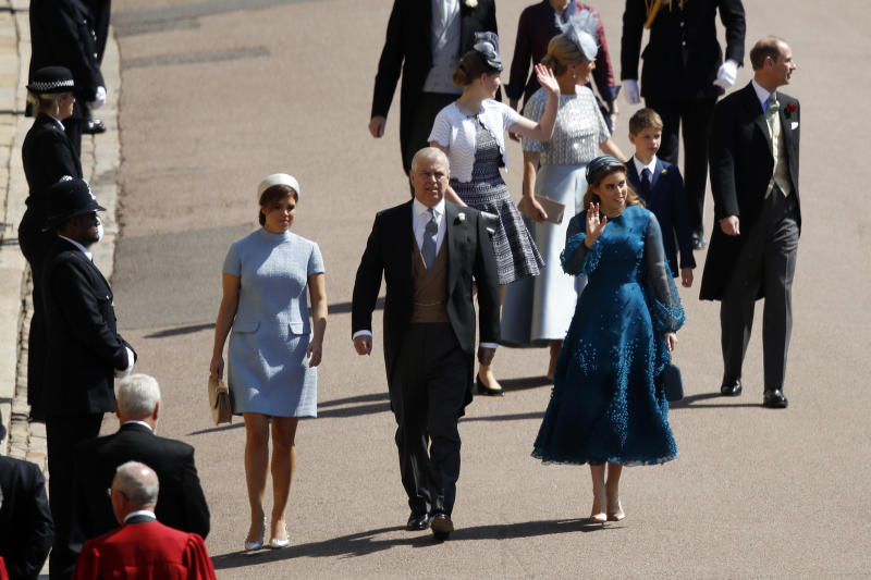 Britain's Prince Andrew, center, arrives with Princess Beatrice, right, and Princess Eugenie arrive for the wedding ceremony of Prince Harry and Meghan Markle at St. George's Chapel in Windsor Castle in Windsor, near London, England, Saturday, May 19, 2018. (Odd Anderson/pool photo via AP)