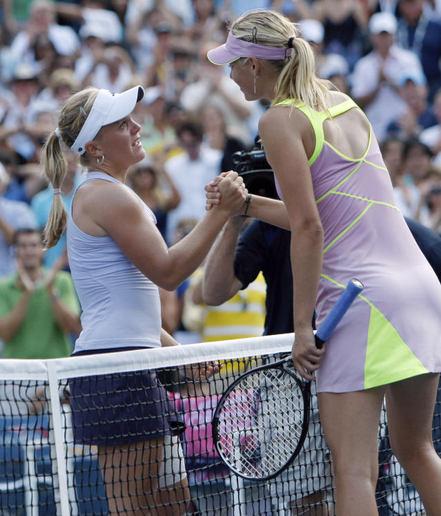 FILE - In this Sept. 5, 2009, file photo, Melanie Oudin, left, of the United States, shakes hands with Maria Sharapova, of Russia, at the net after her upset victory during the third round of the U.S. Open tennis tournament in New York. Oudin won 3-6, 6-4, 7-5. A decade after that magical and memorable Grand Slam stay in New York, which followed a just-as-surprising run from qualifier to the fourth round at Wimbledon--like another American teen, Coco Gauff, did to much more fanfare this summer--Oudin is retired from the WTA tour, teaching kids the sport she loves and hoping to coach a pro one day. (AP Photo/Paul J. Bereswill, File)