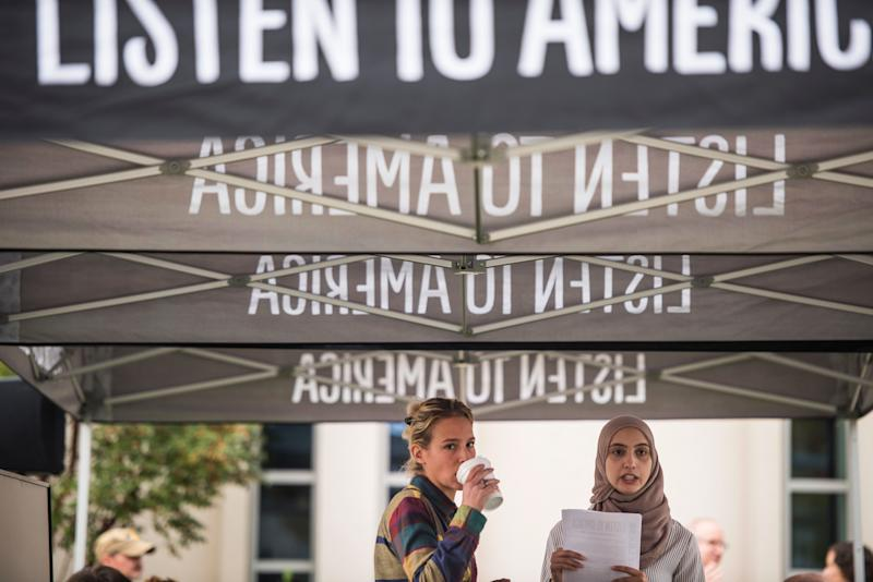 Alanna Vagianos and Rowaida Abdelaziz wait for people to comeand tell their stories.