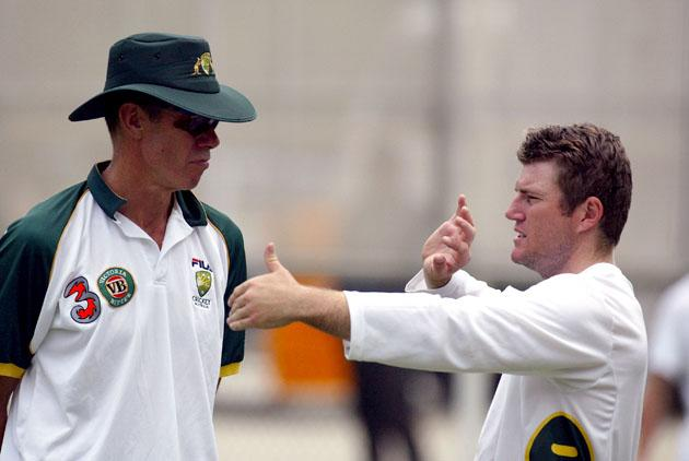 Stuart MacGill of Australia talks with Coach John Buchanan during a team training session in preparation for the test match against India December 2, 2003 at the Gabba in Brisbane, Australia.  (Photo by Jonathan Wood/Getty Images)