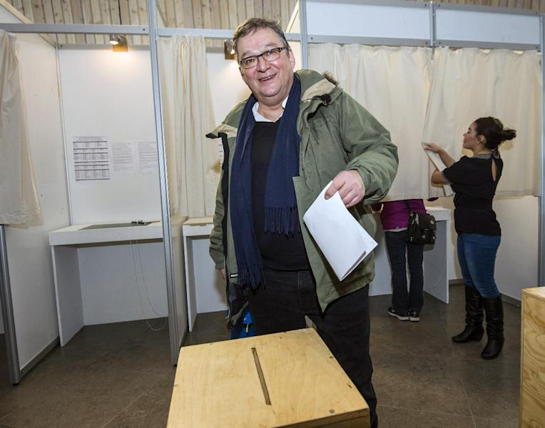 Greenland's Prime Minister Kuupik Kleist casts his ballot for the general election, in Nuuk, Greenland, Tuesday, March 12, 2013. Greenlanders are voting to elect the semi-autonomous nation's 31-seat Parliament amid a strategic debate over how to handle potentially vast underground mineral wealth. (AP Photo/Polfoto, Leiff Josefsen) DENMARK OUT
