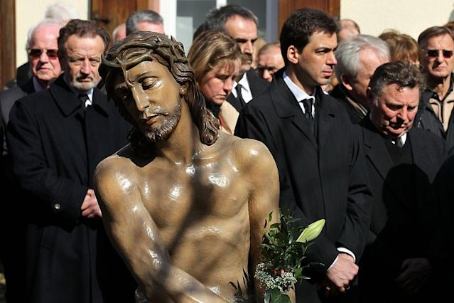 Members of the town's crafts guilds participate in a Good Friday procession on in Lohr am Main, Germany.