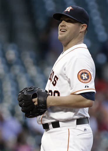 Houston Astros starting pitcher Bud Norris grins during the third inning of a baseball game against the Los Angeles Angels on Wednesday, May 8, 2013, in Houston. Norris pitched eight innings, earning a win, as the Astros defeated the Angels 3-1. (AP Photo/Pat Sullivan)
