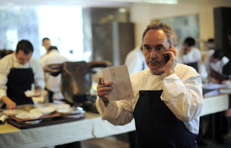FILE - In this March 30, 2011 file photo, Spanish chef Ferran Adria speaks on the phone in his restaurant elBulli in Roses, Spain. Spanish chef Ferran Adria, the man behind the late, lamented elBulli restaurant, is bringing an exhibition dedicated to the art and science of his experimental brand of cooking to London. The show, which was visited by 650,000 people during a year-long run in Barcelona, will be on display from July 5 to Sept. 29, 2013 at London's Somerset House. (AP Photo/Manu Fernandez, File)